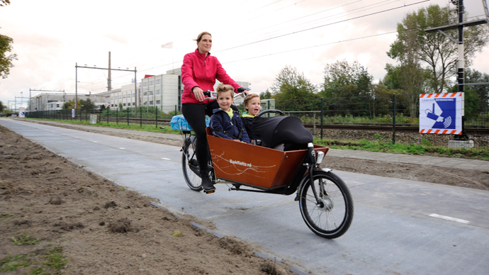Cycling on sunshine: World's first solar bike lane opens in Netherlands