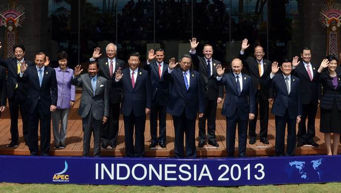 "Various leaders wave for the traditional ""leaders' family photo"" at the Asia-Pacific Economic Cooperation (APEC) Summit in Nusa Dua on the Indonesian resort island of Bali on October 8, 2013.(AFP Photo / Romeo Gacad)"