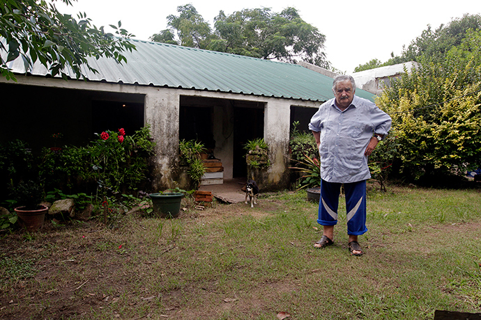 Uruguay's President Jose Mujica poses for a picture in front of his farmhouse following an interview with Reuters, on the outskirts of Montevideo (Reuters / Andres Stapff)