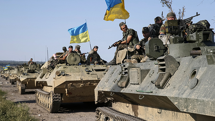 Ukrainian servicemen ride on armoured vehicles near Slaviansk (Reuters / Gleb Garanich)