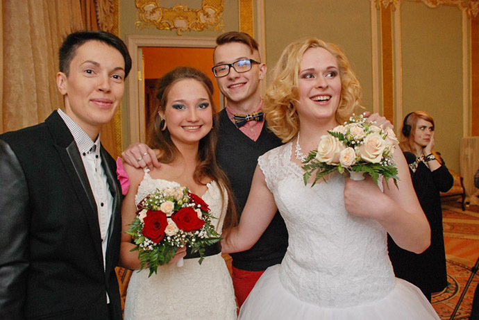 Irina Shumilova, (R ) and Alyona Fursova (L ) pose with their friends at the wedding registry office. Photo courtesy of Irina (VK.com)