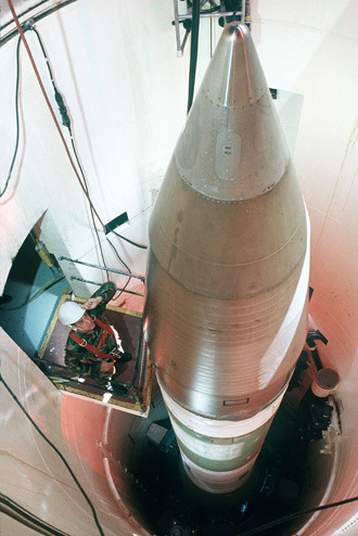 This US Air Force handout file image shows an Air Force technician inspecting an LGM-30G Minuteman III missile inside a silo about 60 miles from Grand Forks Air Force Base, in North Dakota. (AFP Photo/US Air Force)