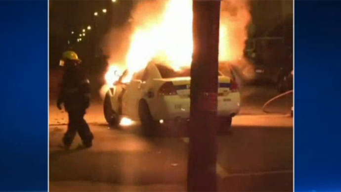 High school firefighter rescues cop from burning cruiser (VIDEO)