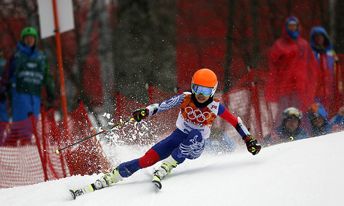 Vanessa Mae, competing for Thailand under her father's name Vanessa Vanakorn, skis during the first run of the women's alpine skiing giant slalom event at the 2014 Sochi Winter Olympics at the Rosa Khutor Alpine Center February 18, 2014. (Reuters/Stefano Rellandini)