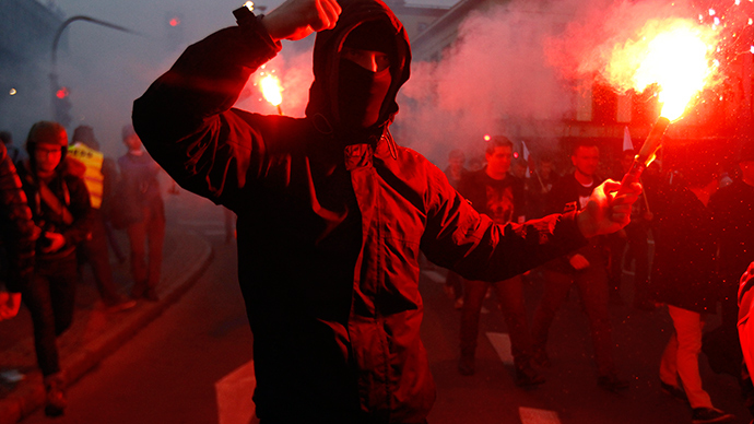 A far-right protester holds a flare during the annual far-right rally, which coincides with Poland's National Independence Day in Warsaw November 11, 2014 (Reuters / Kacper Pempel)