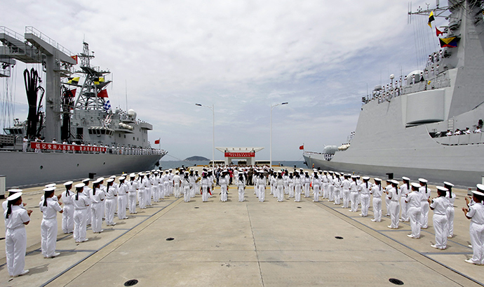 Chinese navy sailors stand in formation as they attend a send-off ceremony before departing for the Rim of the Pacific exercise (RIMPAC), at a military port in Sanya, Hainan province June 9, 2014 (Reuters / Stringer)