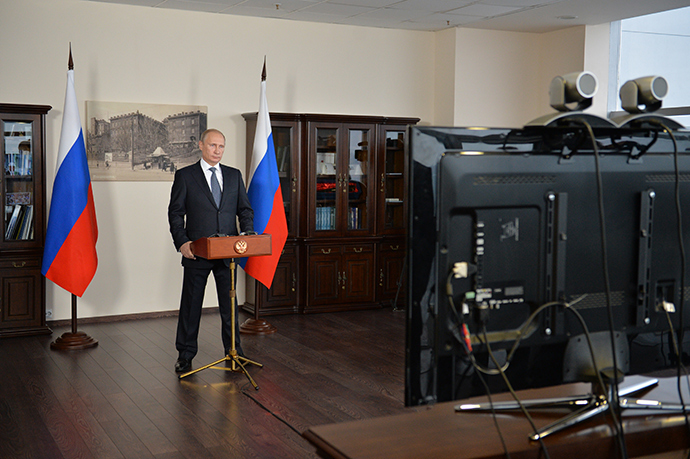 November 12, 2014. President Vladimir Putin participates in the launch of the last out of ten hydropower units of the Sayano-Shushenskaya Hydropower Plant damaged in a 2009 accident, during a teleconference (RIA Novosti / Alexey Druzhinin)