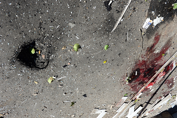 A photo taken on October 3, 2014 shows the scene of a rocket attack which killed a Swiss International Committee of the Red Cross (ICRC) worker outside the International Committee of the Red Cross office in Donetsk the day before. Shelling in the center of the main rebel-held city in Ukraine's east killed a Swiss Red Cross worker on October 2, tearing badly at a weakly observed four-week truce meant to defuse Europe's worst crisis in decades (AFP Photo / John Macdougal)