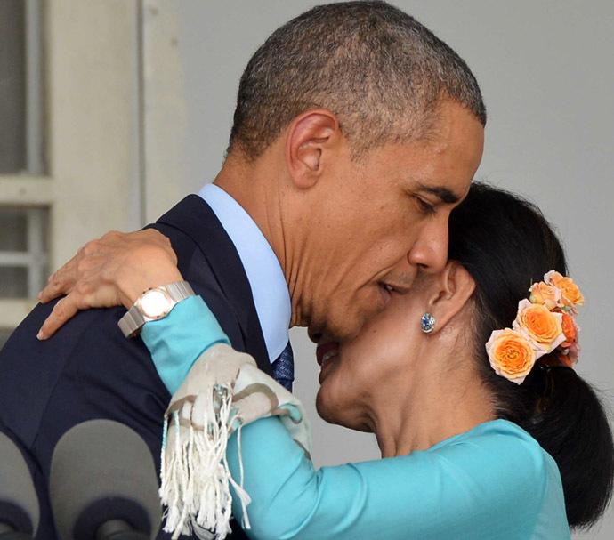 US President Barack Obama embraces Myanmar's opposition leader Aung San Suu Kyi during a press conference at her residence in Yangon on November 14, 2014 (AFP Photo/Mandel Ngan)