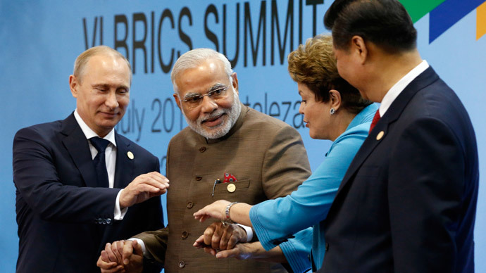 (L-R) Russia's President Vladimir Putin, India's Prime Minister Narendra Modi, Brazil's President Dilma Rousseff and China's President Xi Jinping pose for a group picture during the VI BRICS Summit in Fortaleza July 15, 2014.(Reuters / Paulo Whitaker)