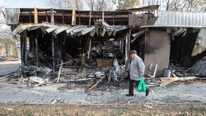 A man walks past shops damaged by recent shellings in Donetsk, eastern Ukraine, October 21, 2014.(Reuters / Shamil Zhumato)