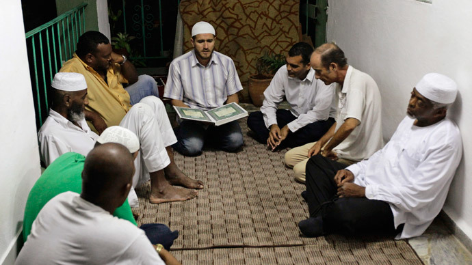 Cuban Muslims listen to verses from the Koran after their Iftar (fast-breaking) meal during the Islamic holy month of Ramadan in Havana.(Reuters / Desmond Boylan)