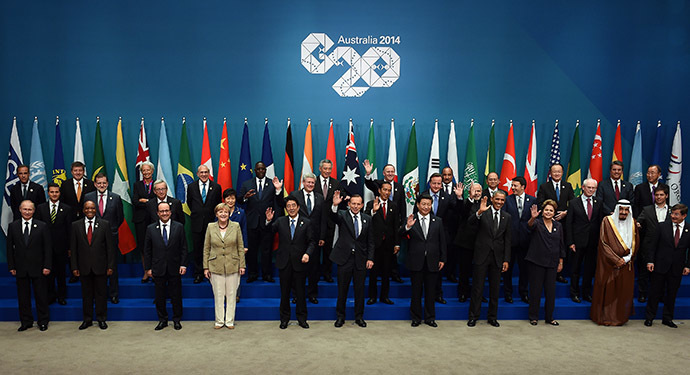 "Heads of states and international organizations pose for the ""family photo"" during the G20 Summit in Brisbane on November 15, 2014. (AFP Photo/Saeed Khan)"