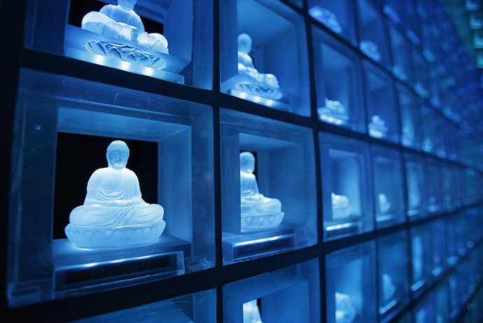 "Buddha statues carved in crystals are pictured at the ""Ruriden"", a cemetery that uses high-powered LED lights to illuminate over 2,000 Buddha statues, in downtown Tokyo October 27, 2014. (Reuters/Toru Hanai)"