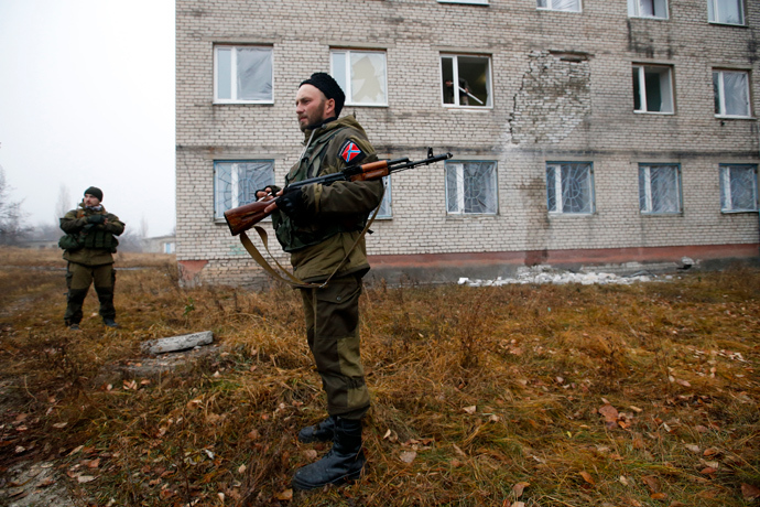 A rebels stand guard outside the building of perinatal centre damaged by, what locals say, was shelling by Ukrainian forces in the town of Pervomaisk, west of Lugansk, eastern Ukraine (Reuters / Maxim Zmeyev)