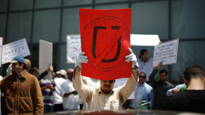 Commercial drivers with the app-based, ride-sharing company Uber protest against working conditions outside the company's office in Santa Monica, California June 24, 2014.(Reuters / Lucy Nicholson)