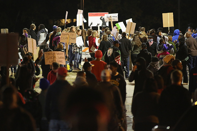 Police face off with demonstrators as protests continue in the wake of 18-year-old Michael Brown's death on October 22, 2014 in Ferguson, Missouri. (Scott Olson / Getty Images / AFP)