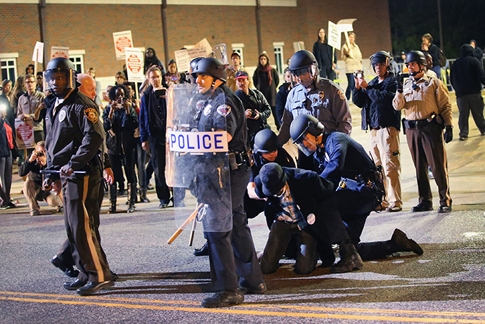 Police arrest a demonstrator outside the police station as protests continue in the wake of 18-year-old Michael Brown's death on October 22, 2014 in Ferguson, Missouri. (Scott Olson / Getty Images / AFP)