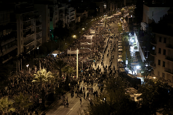 Demonstrators march in front of the US embassy on November 17, 2014 in the centre of Athens during a march commemorating the 1973 students uprising against the military junta. (AFP Photo / Angelos Tzortzinis)