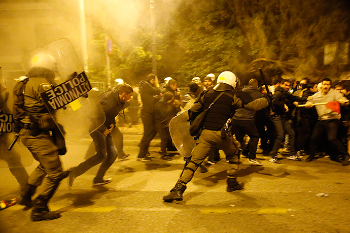 Riot policemen clash with protesters at a rally marking the 41st anniversary of a 1973 student uprising against a U.S. backed military dictatorship in then ruling Greece, near the U.S. embassy in Athens November 17, 2014. (Reuters / Yannis Behrakis)