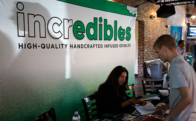A job applicant (R) talks to a recruiter at the incredibles company booth at the CannaSearch cannabis industry job fair in downtown Denver (Reuters / Rick Wilking)
