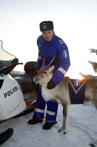 Finnish policeman and official police reindeer (photo from imgur.com/gallery/10QogDd )