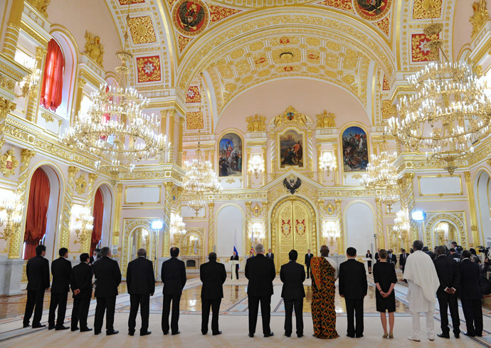President Vladimir Putin, center, speaks during the ceremony of presenting credentials from new foreign ambassadors in the Grand Kremlin Palace's Alexander Hall. (RIA Novosti/Michael Klimentyev)