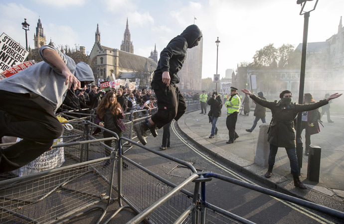 Demonstrators break through barricades in Parliament Square in front of the Houses of Parliament, as they participate in a protest against student loans and in favour of free education, in central London November 19, 2014. (Reuters/Peter Nicholls)