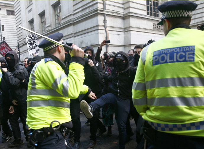 Demonstrators are confronted by police officers as they participate in a protest against student loans and in favour of free education, in central London November 19, 2014. (Reuters/Eddie Keogh)