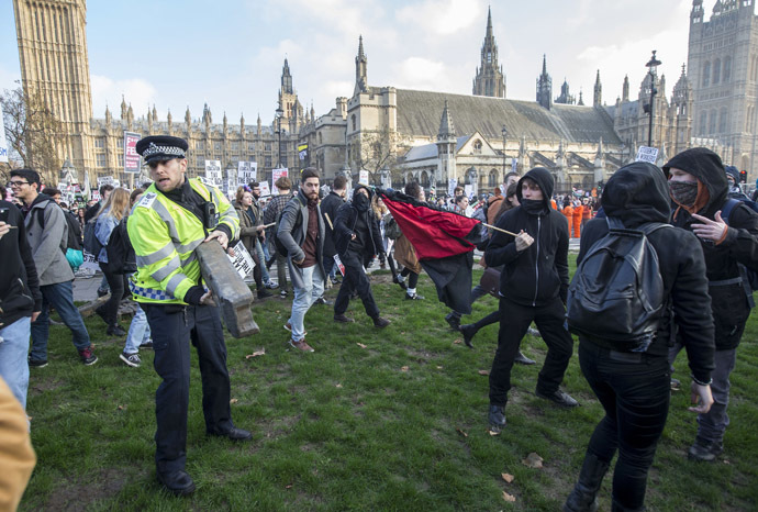 Demonstrators walk in Parliament Square in front of the Houses of Parliament, as they participate in a protest against student loans and in favour of free education, in central London November 19, 2014. (Reuters/Peter Nicholls)