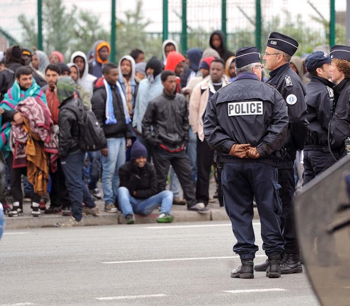 Illegal immigrants wait to be expelled from their camp at Calais on May 28, 2014. (AFP Photo/Denis Charlet)