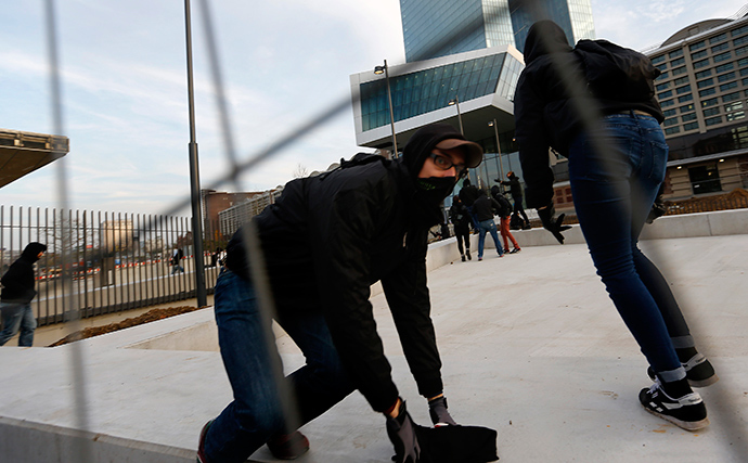 2014Blockupy protesters break through fences in front of the new European Central Bank (ECB) headquarters during a demonstration in Frankfurt November 22, 2014 (Reuters / Kai Pfaffenbach)