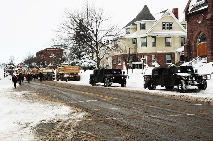 This US Army National Guard photo shows New York Army National Guard Soldiers from the 152nd Engineer Company as they use engineering equipment to assist in snow removal on November 20, 2014 efforts in Buffalo, New York. (AFP Photo/US Army National Guard/Senior Master Sgt. Ray Lloyd)