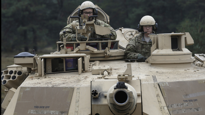 U.S. soldiers deployed in Latvia sit in an Abrams tank during a drill at Adazi military base October 14, 2014. (Reuters / Ints Kalnins)