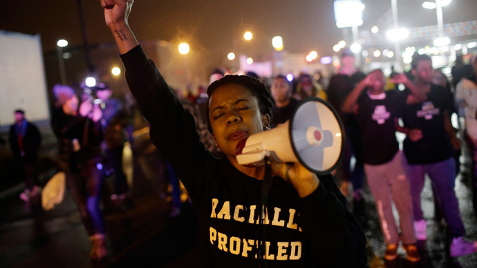 Arming for Ferguson post-verdict turmoil, woman fatally shoots self