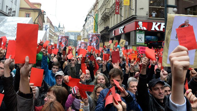 Demonstrators show red cards for Czech President Milos Zeman during a rally to commemorate the 25th anniversary of the Velvet Revolution on November 17, 2014 at Narodni street in Prague. (AFP Photo/Michal Cizek)