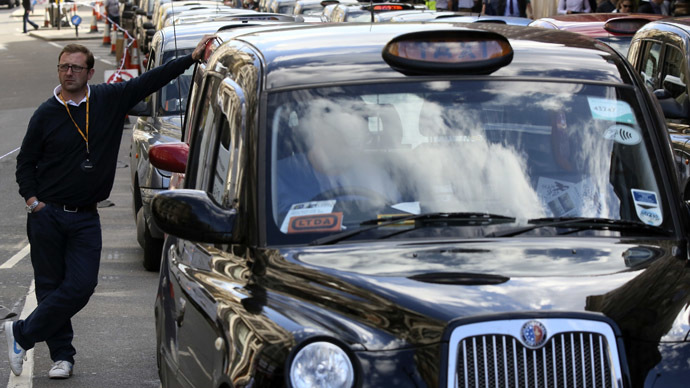 London cab drivers enlist private detectives in Uber taxi wars