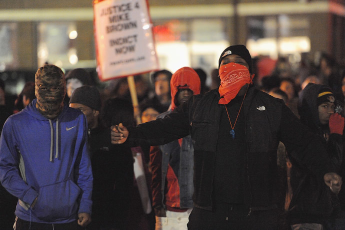 Demonstrators gather outside the Ferguson Police Department in Ferguson Missouri, on November 24, 2014 to protest the death of 18-year-old unarmed black teenager Michael Brown, who was shot to death by a white police officer. (AFP Photo/Michael B. Thomas)