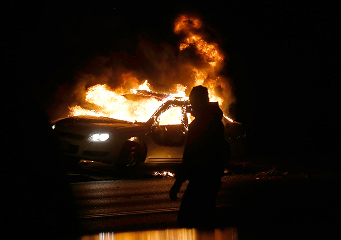 A car burns on the street after a grand jury returned no indictment in the shooting of Michael Brown in Ferguson, Missouri November 24, 2014 (Reuters / Jim Young)