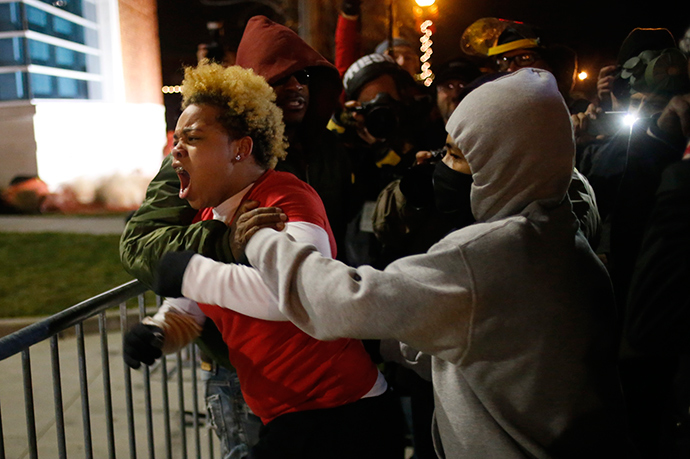 A woman approaches the barricade to confront the police outside the Ferguson Police Department in Ferguson, Missouri, November 24, 2014 (Reuters / Adrees Latif)