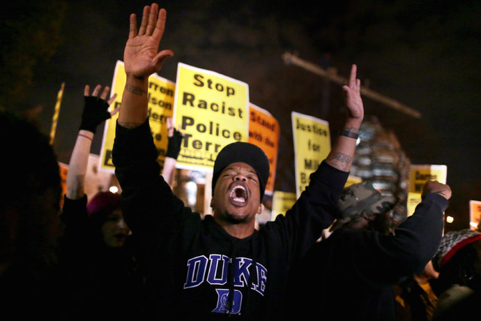 Hundreds of demonstrators gather to protest the day after the Ferguson grand jury decision to not indict officer Darren Wilson in the Michael Brown case November 25, 2014 in Washington, DC. (Chip Somodevilla/Getty Images/AFP)
