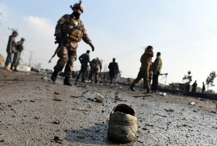 A shoe belonging to a man killed in a suicide attack is pictured at the scene along the Kabul-Jalalabad road in Kabul on November 27, 2014. (AFP Photo/Shah Marai)