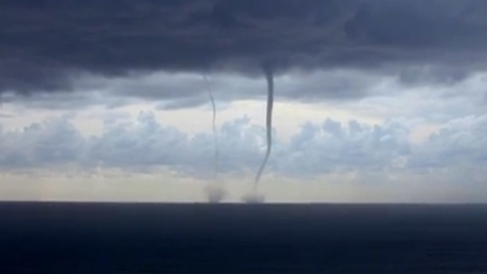 Wet waltz: Rare twin waterspouts elegantly dance off Italian coast (VIDEO)