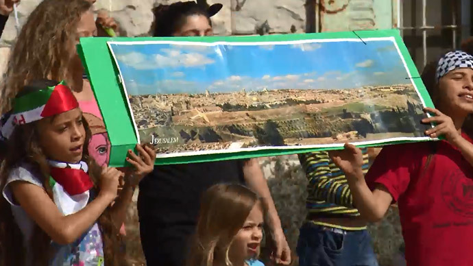The young citizen journalist participates in a demonstration protesting Israeli occupation in her home village.(A screenshot from a video by YouTube user David Reeb)