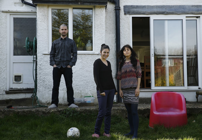 Romanian migrants Marius Spiridon and sisters Mihaela and Andreea Toniciuc (R) pose in the garden of the house where Marius lodges, after an interview with Reuters in Hendon, north London March 15, 2014. (Reuters/Luke MacGregor)