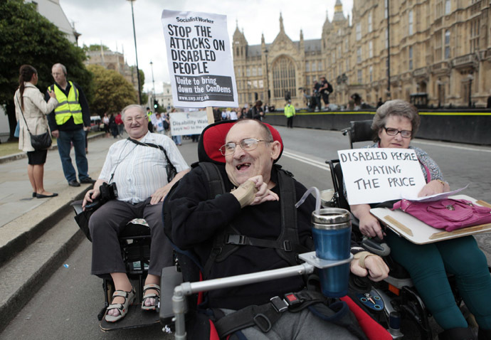"Disabled people demonstrate during ""The Hardest Hit"" march, as they protest against cutbacks to local services and government disability allowance spending cuts, London May 11, 2011. (Reuters/Olivia Harris)"