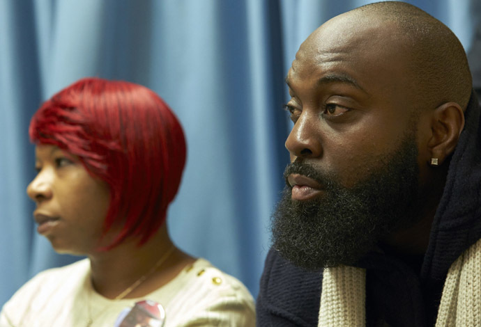 The mother, Lesley McSpadden (L) and father, Michael Brown Sr., of slain teenager Michael Brown, hold a news conference in Geneva November 12, 2014. (Reuters/Denis Balibouse)
