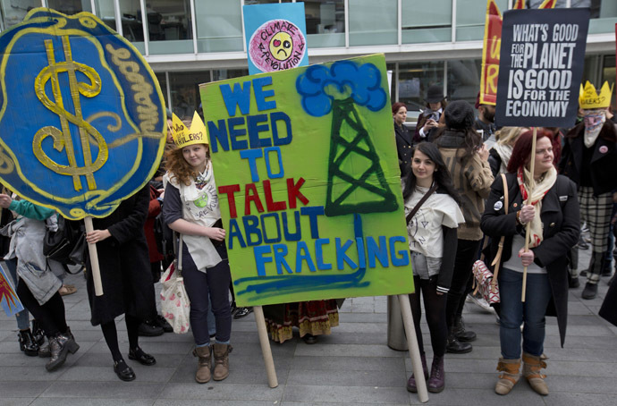 Demonstrators hold banners during an anti-fracking protest in central London. (Reuters/Neil Hall)