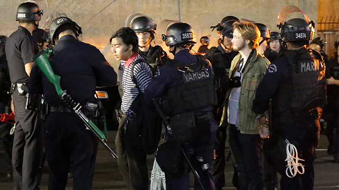 Two men are detained before being released with a warning by the LAPD during a demonstration against the grand jury's decision in the Ferguson, Missouri shooting of Michael Brown, in Los Angeles, California November 28, 2014 (Reuters / Jonathan Alcorn)