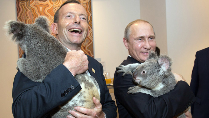 Australia's Prime Minister Tony Abbott (L) and Russia's President Vladimir Putin as they meet Koalas before the start of the first G20 meeting in Brisbane.(AFP Photo / Andrew Taylo)